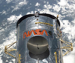HST on orbit during a servicing mission
