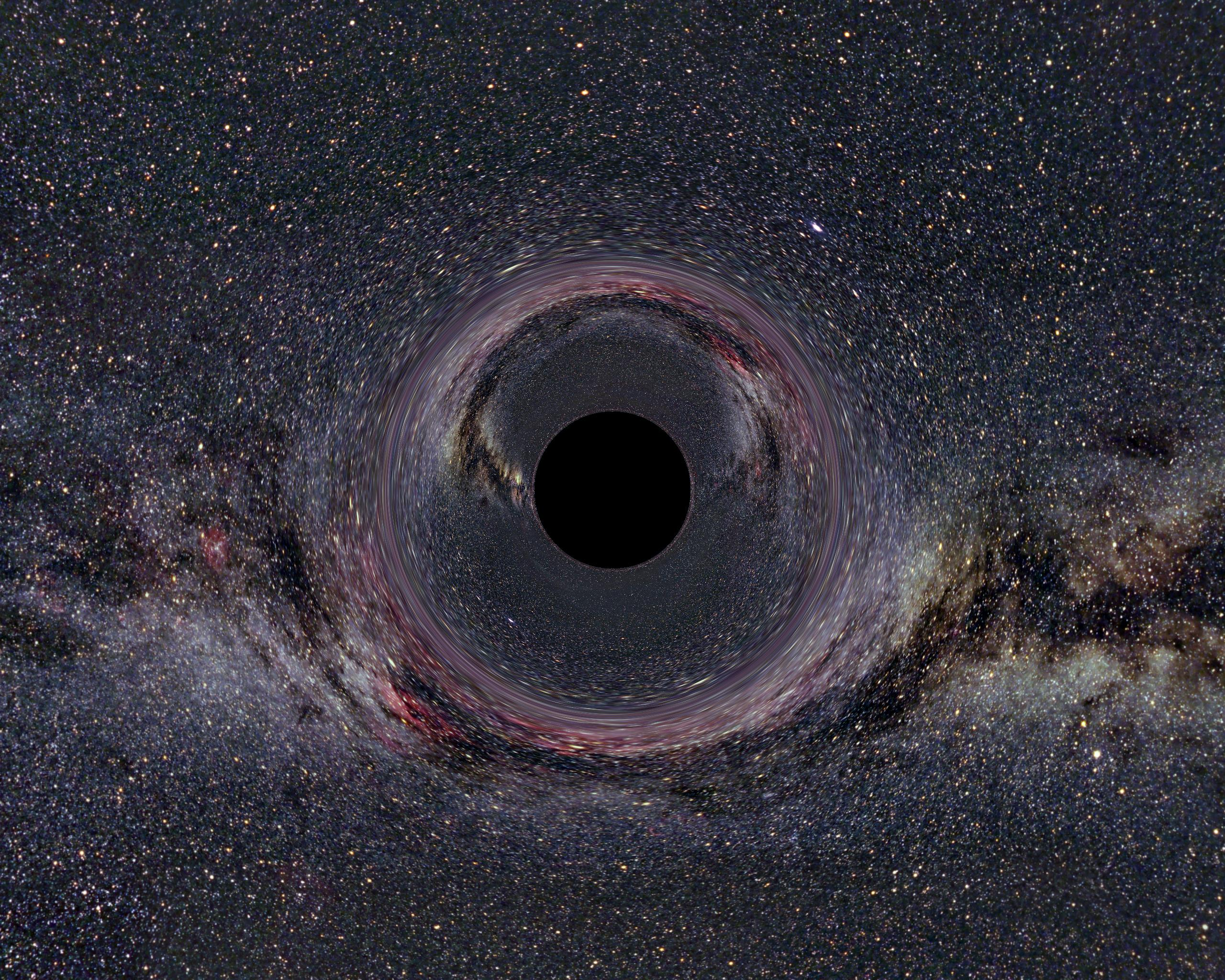 A simulated view of a 10-solar-mass black hole 600 miles (900 km) away from the observer -- and against the plane of the Milky Way Galaxy.  (Courtesy Wikimedia)